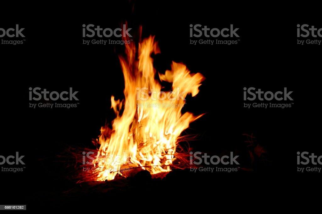 camp fire in desert stock photo