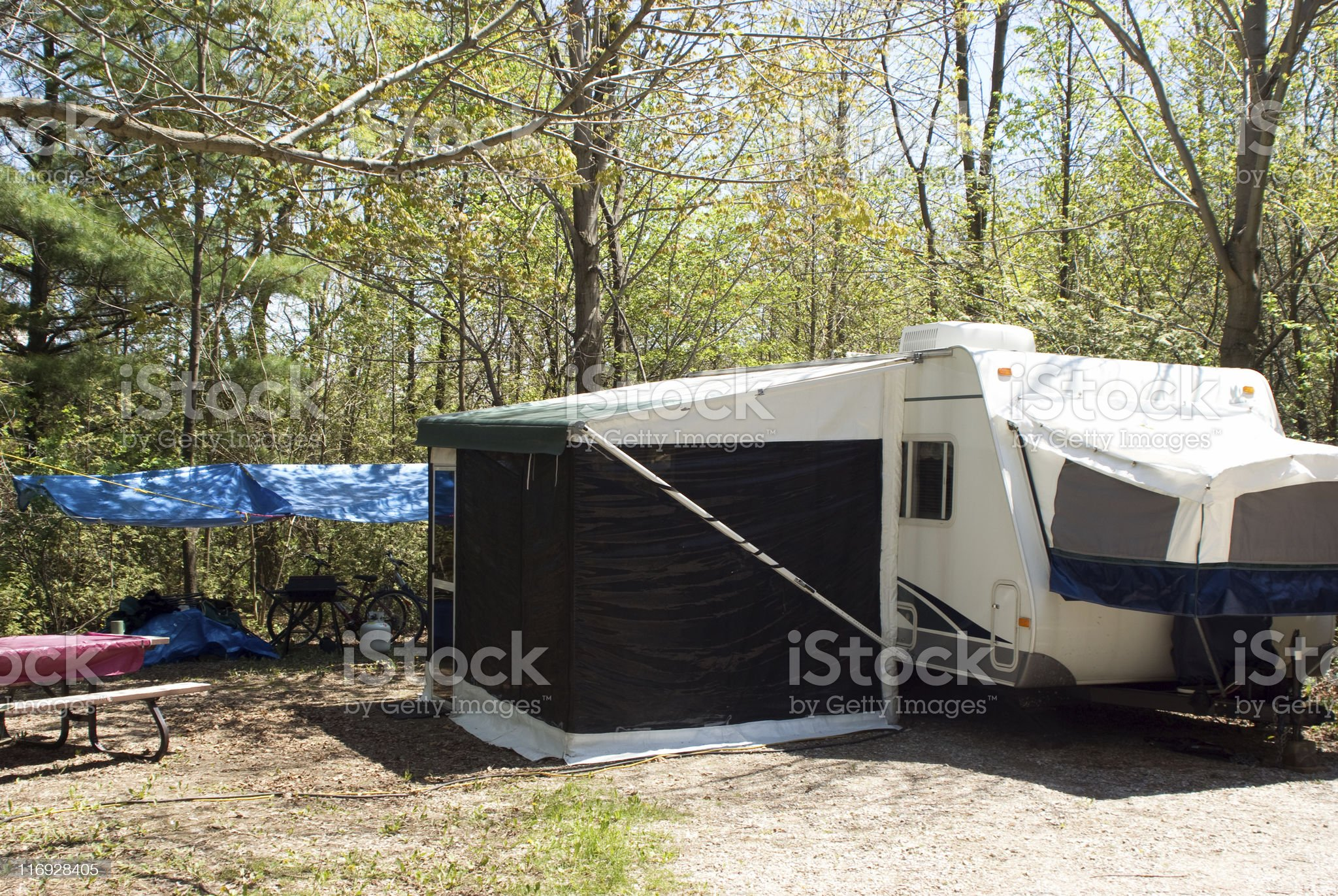 Camp Grounds Vacation Tent Trailer with Screened Porch royalty-free stock photo