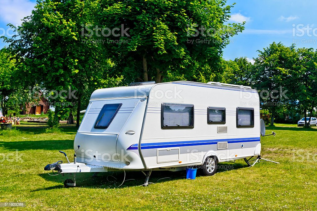 Camp trailer on the camping stock photo