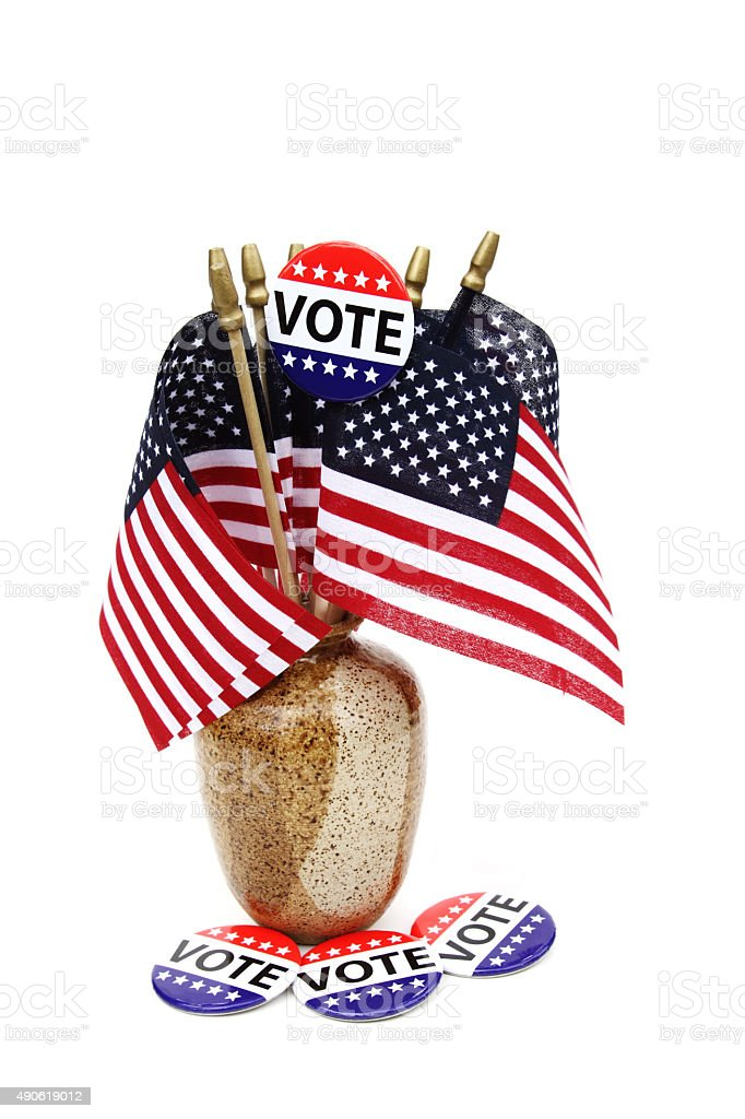 VOTE campaign button on  American flags stock photo