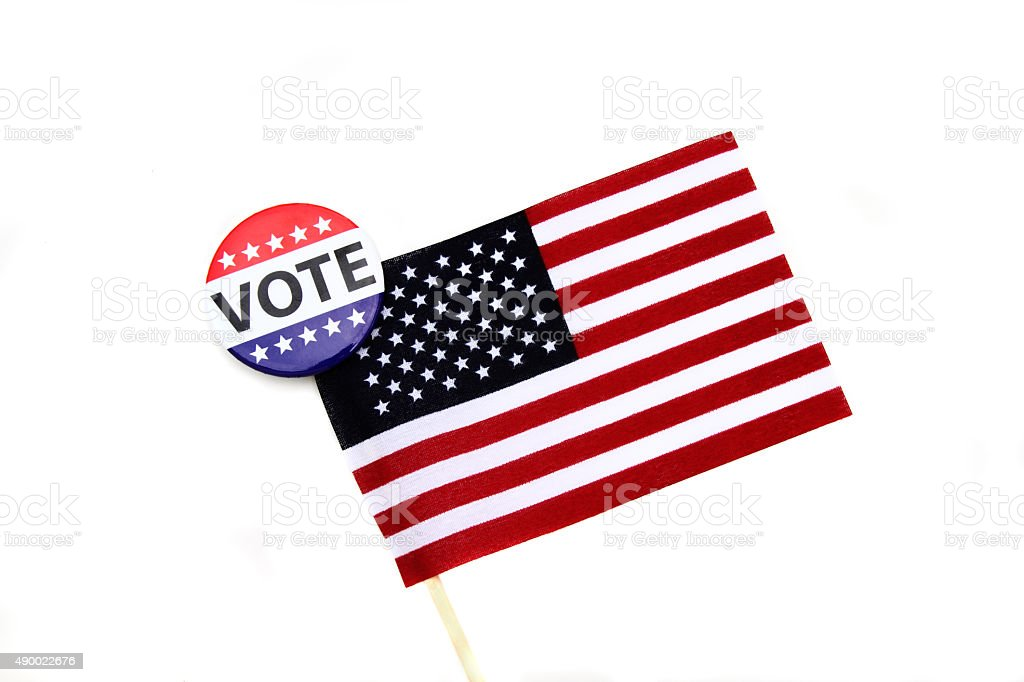 VOTE campaign button on end of American flag stock photo