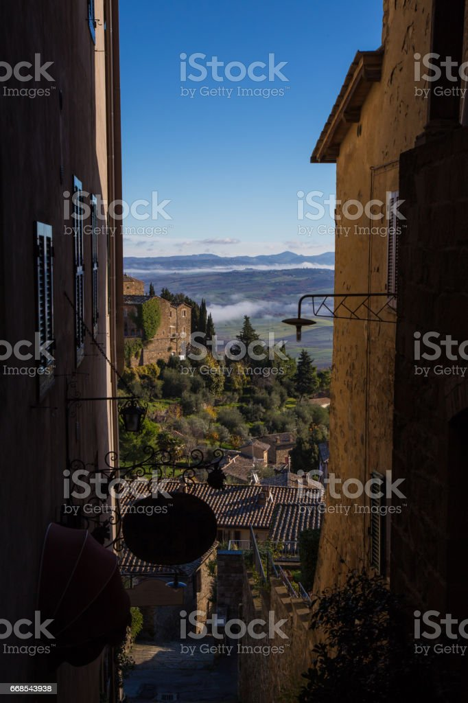 Campaign glimpse Tuscany seen from an alley in Montalcino stock photo