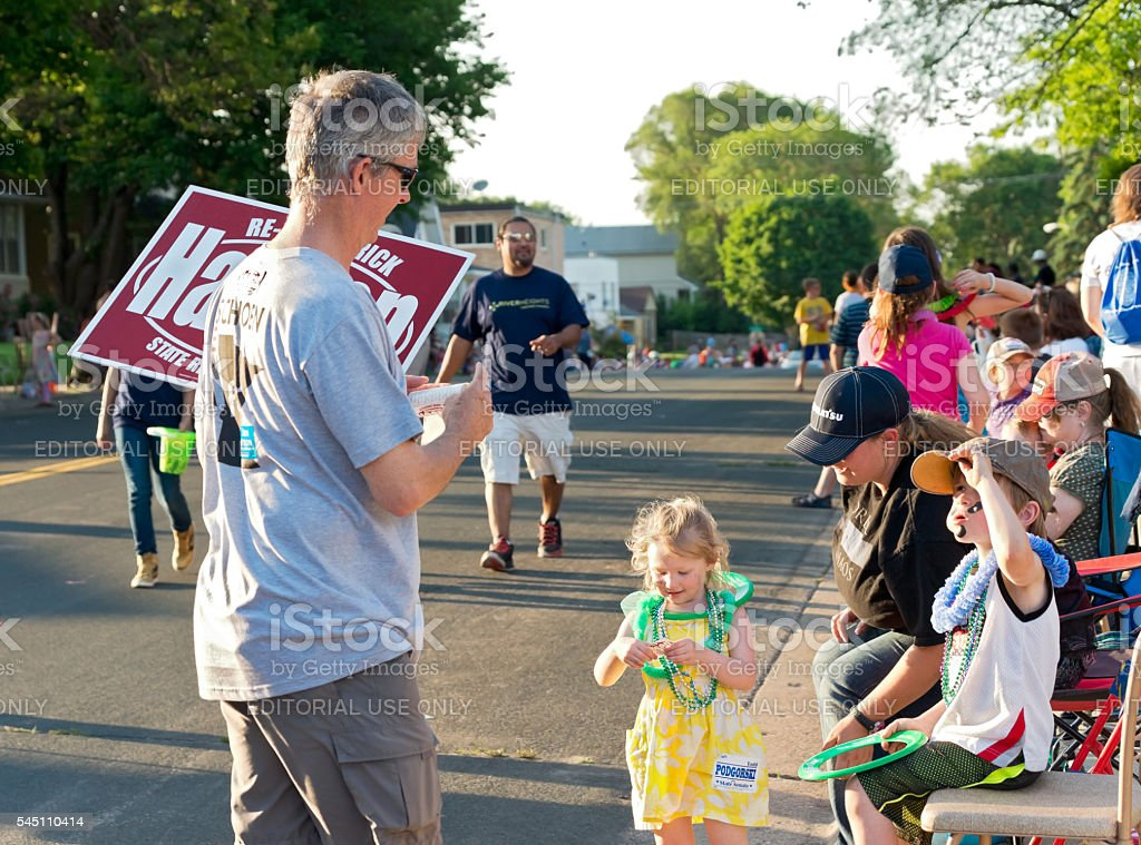 Campaign Worker and Family at Parade stock photo