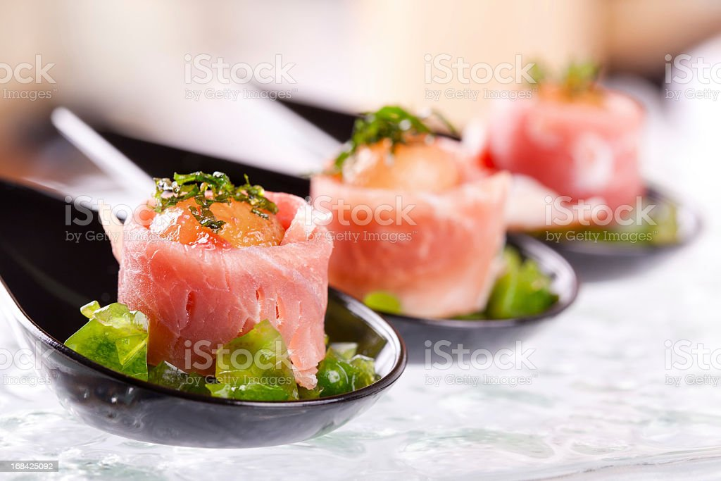 Campari infused melon with prosciutto and mint crystals stock photo