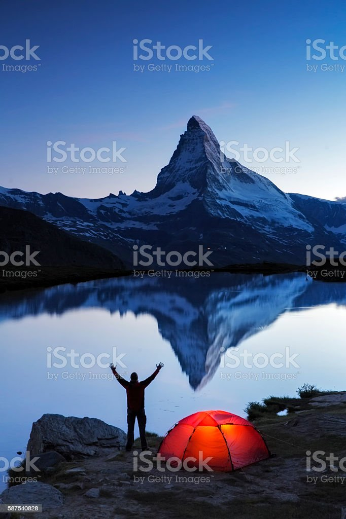 Camper at dawn looks to  Matterhorn stock photo