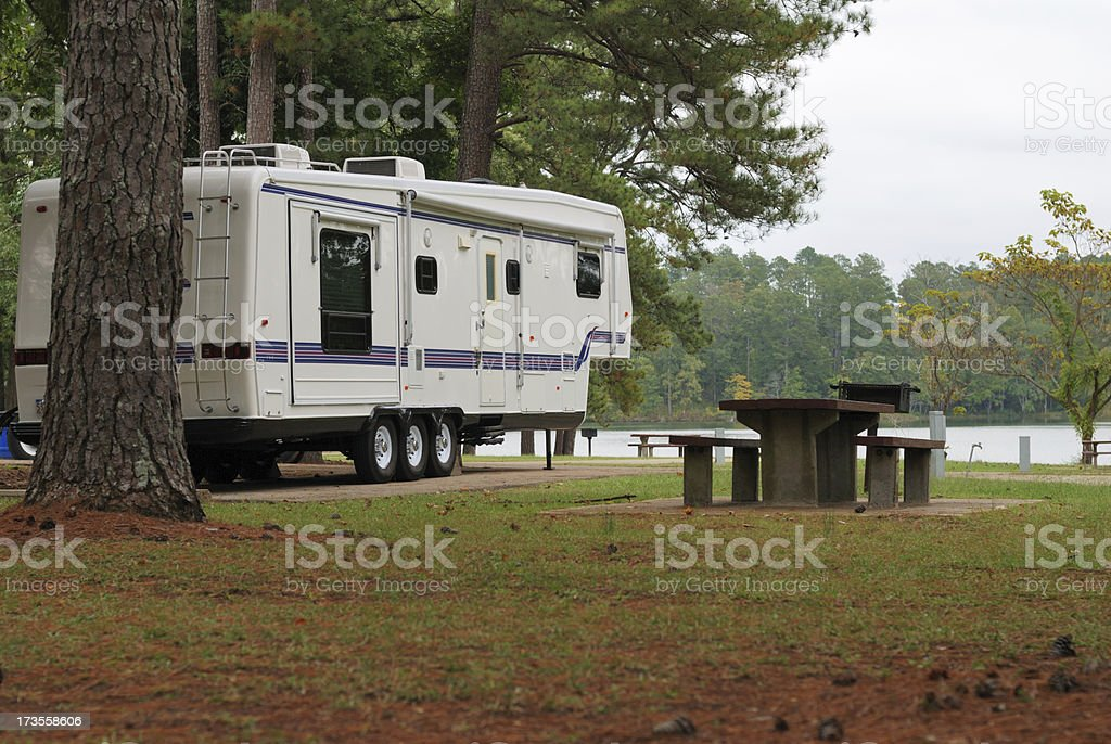 Camper by lake stock photo