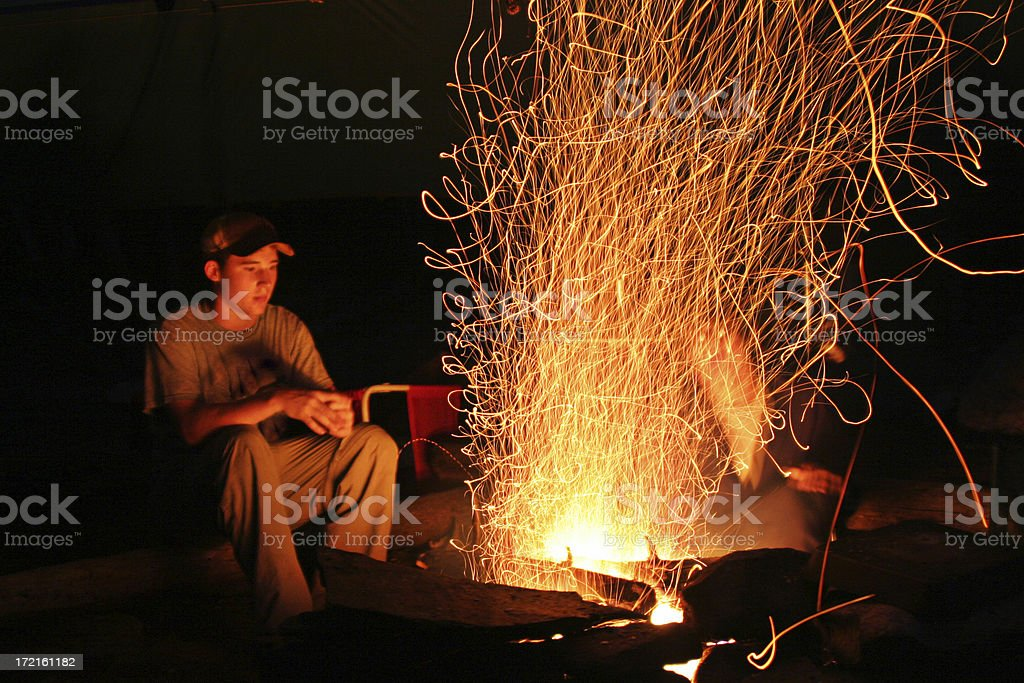 Camper enjoying night time campfire royalty-free stock photo