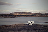 Camper Parked on Lake Pleasant Shoreline with Vintage Effects