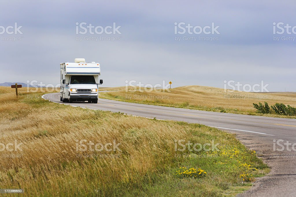 Camper Recreational Vehicle on Road Trip through Badlands, South Dakota stock photo