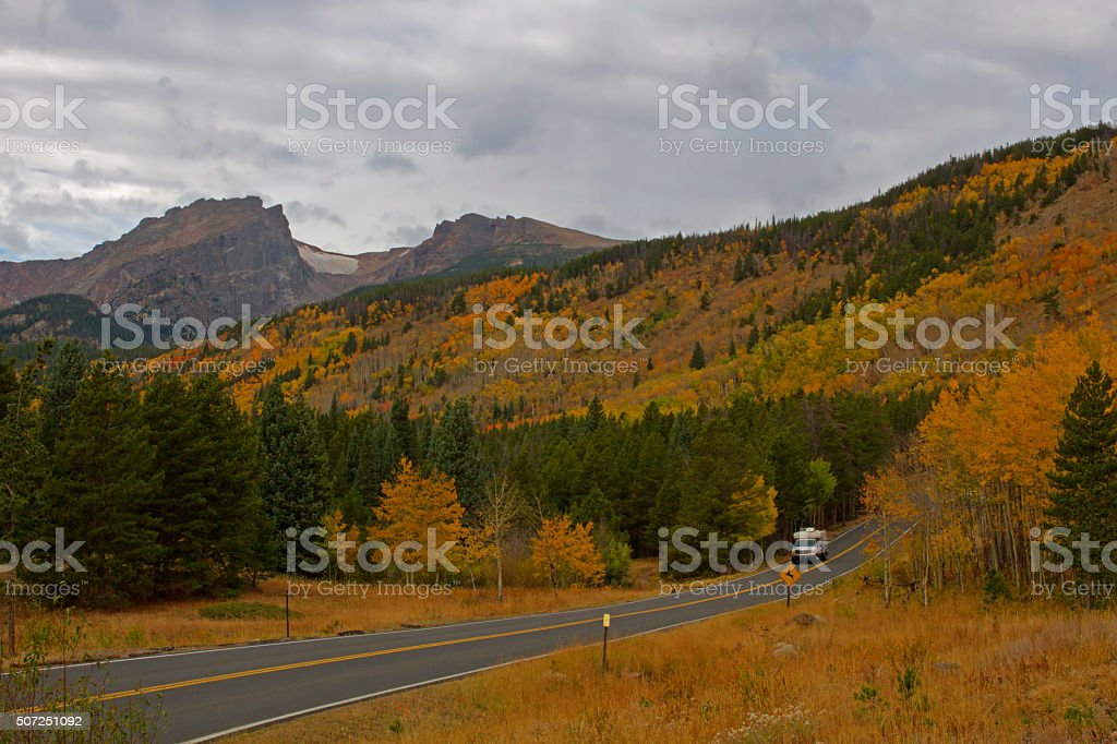 Camper travels along Bear Lake Road in Rocky Mountain National stock photo