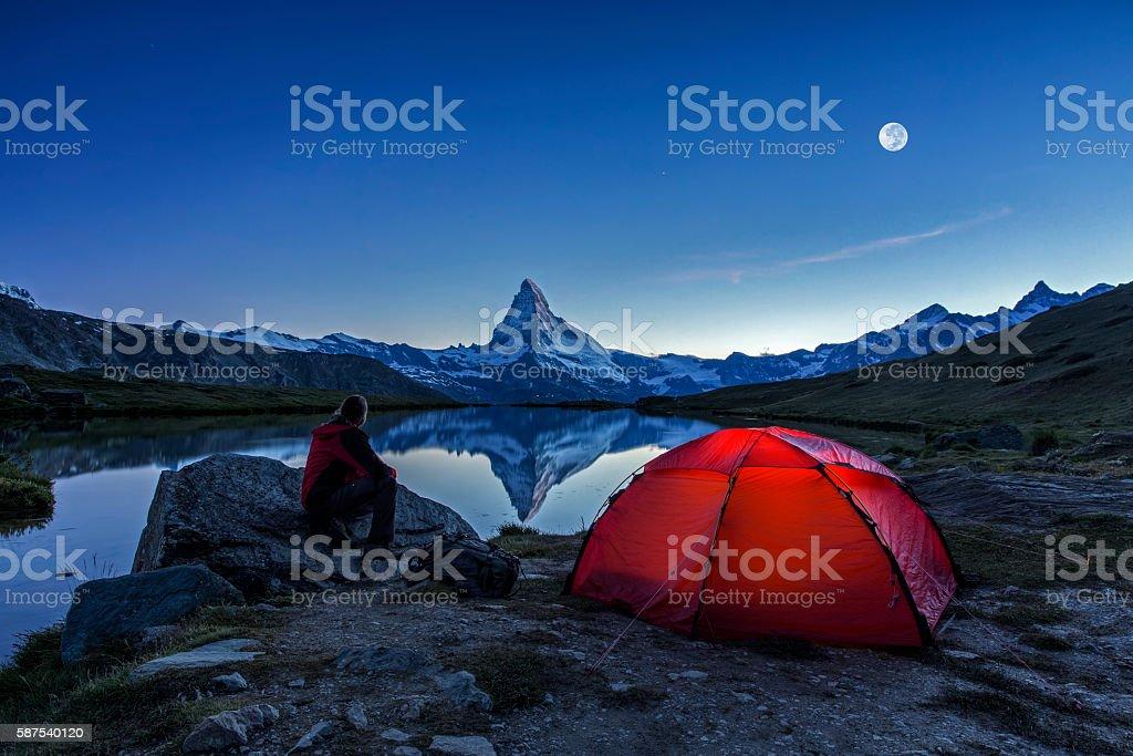 Camper under full Moon at Matterhorn stock photo