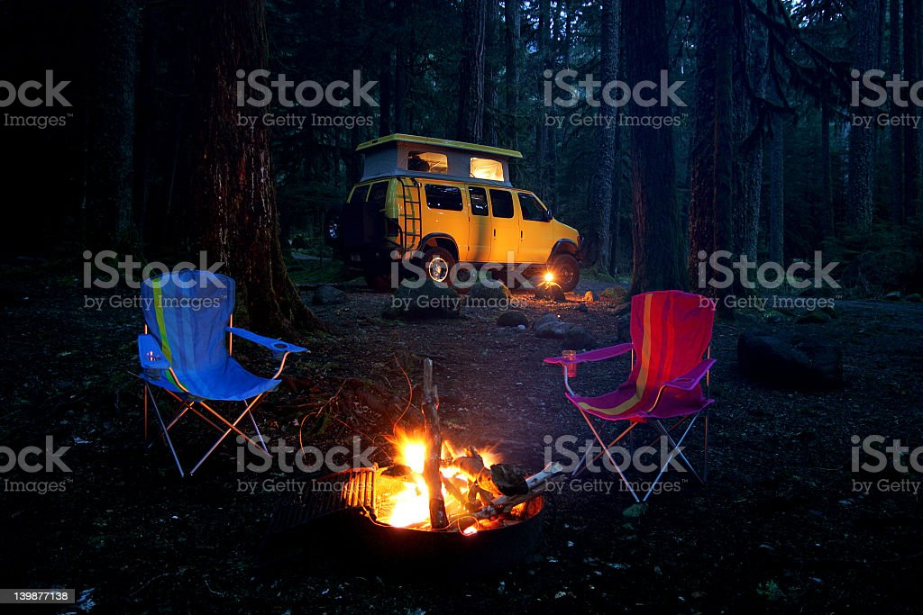 A camper van and camping equipment stock photo