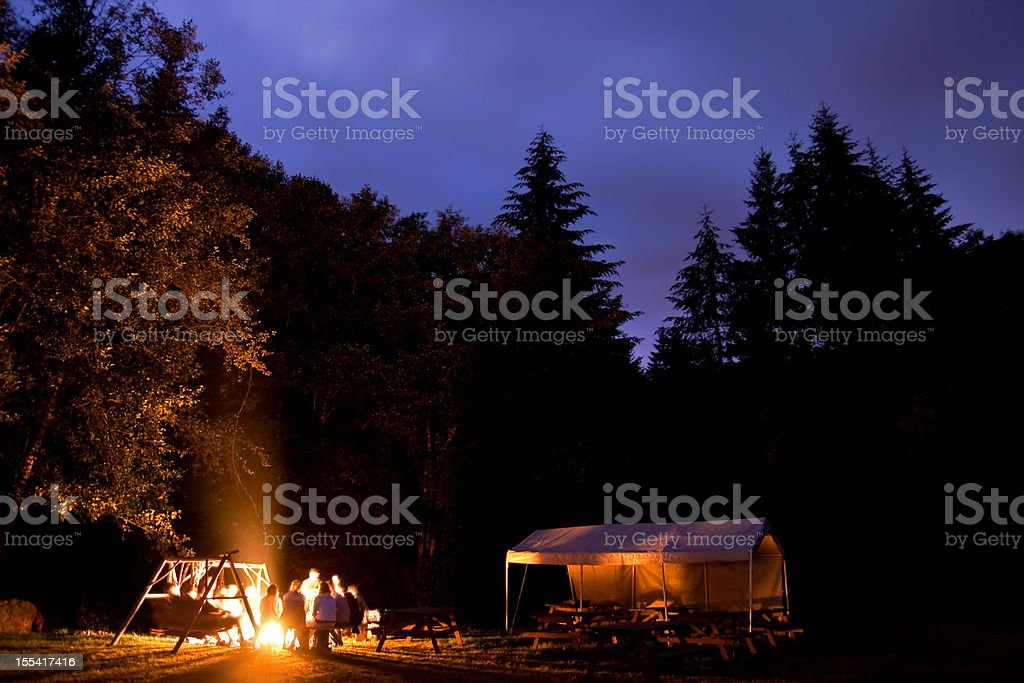 Campers Around Camp Fire stock photo