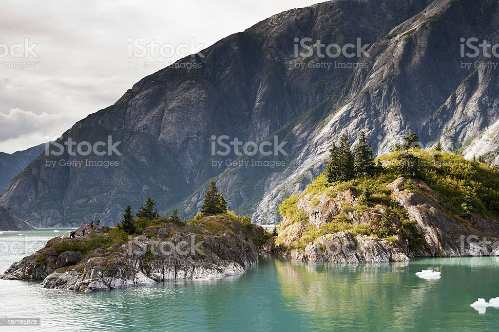 Campers on remote island in Alaska stock photo