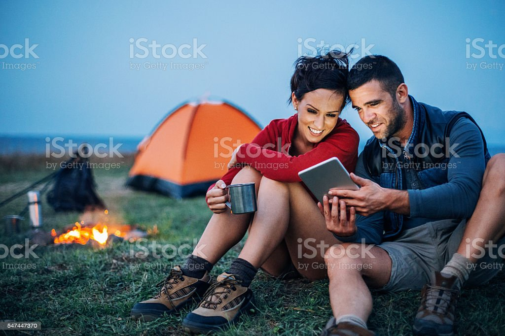 Campers with digital tablet stock photo