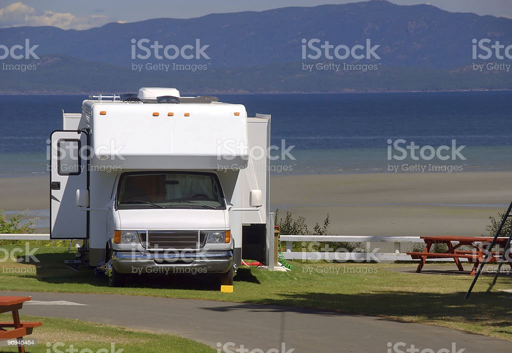 Campervan parked by the side of the sea stock photo