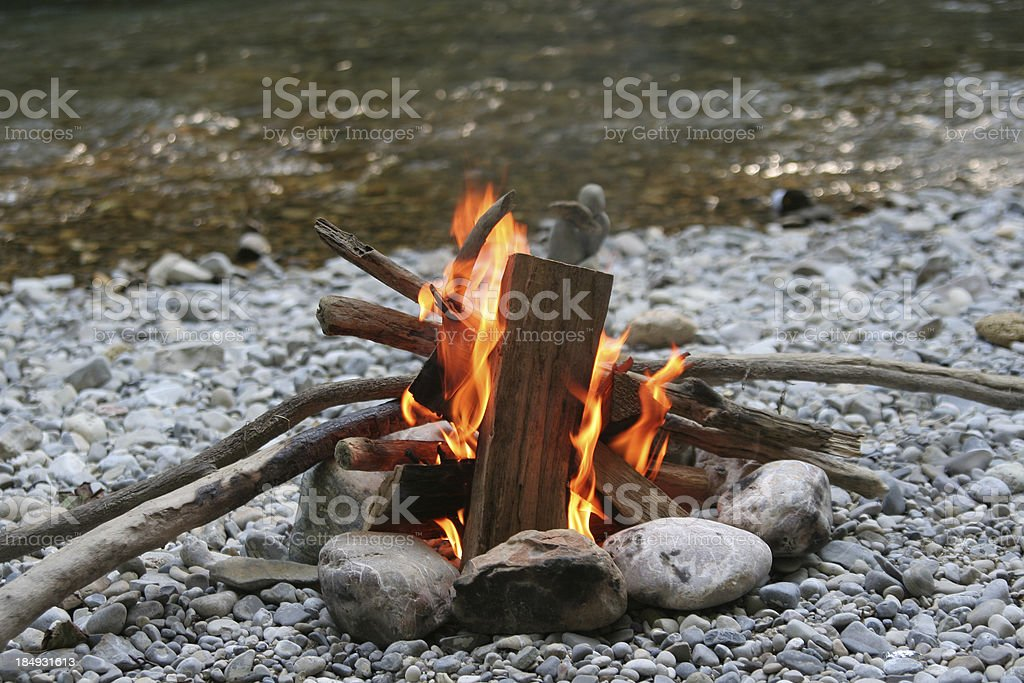 Campfire at the river stock photo