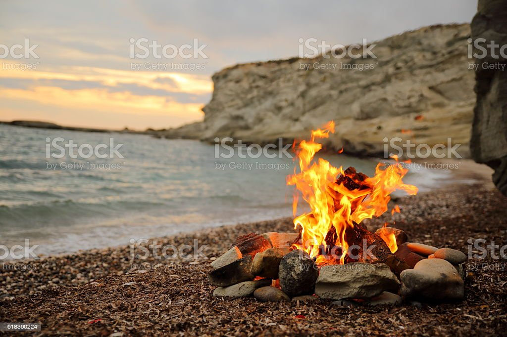 campfire on sea stock photo