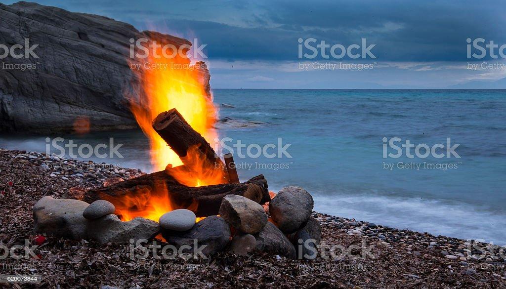 Campfire on sea stock photo