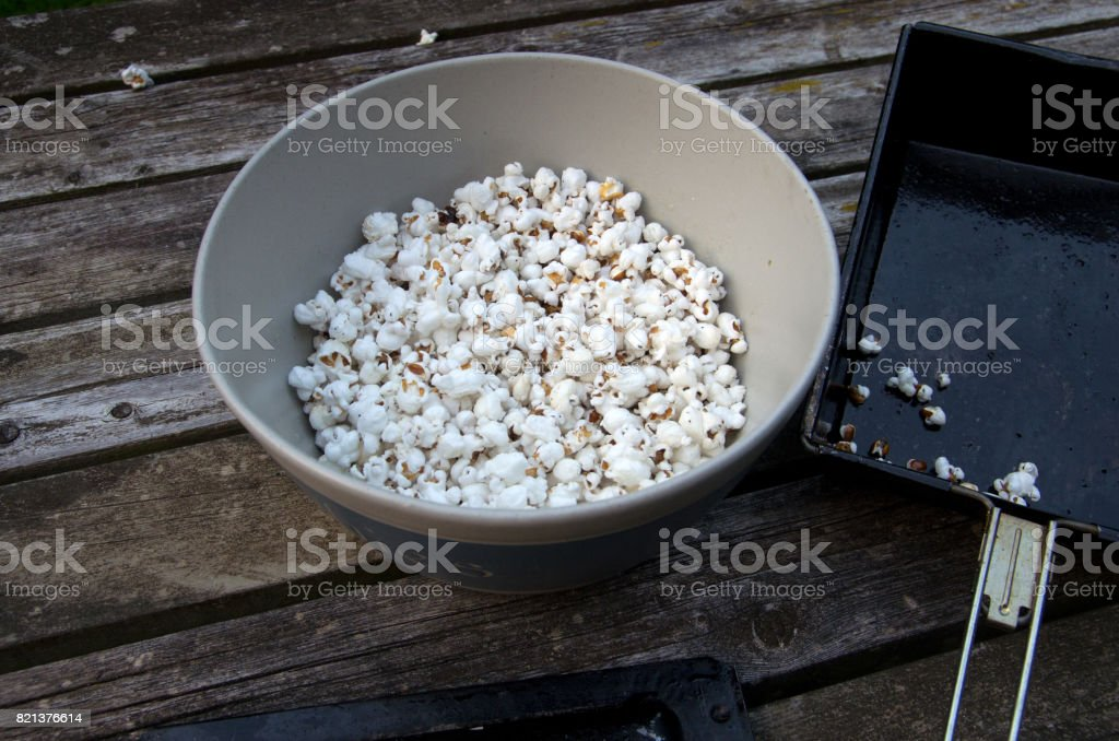 Campfire Popcorn Popper and Bowl stock photo
