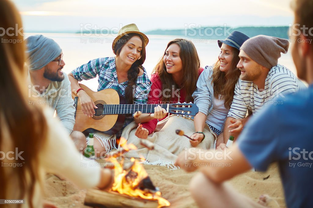 Campfire singing stock photo
