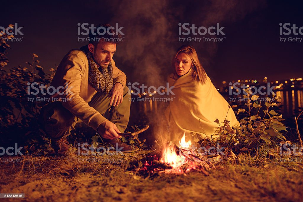 Campfire will keep us warm in the night! stock photo