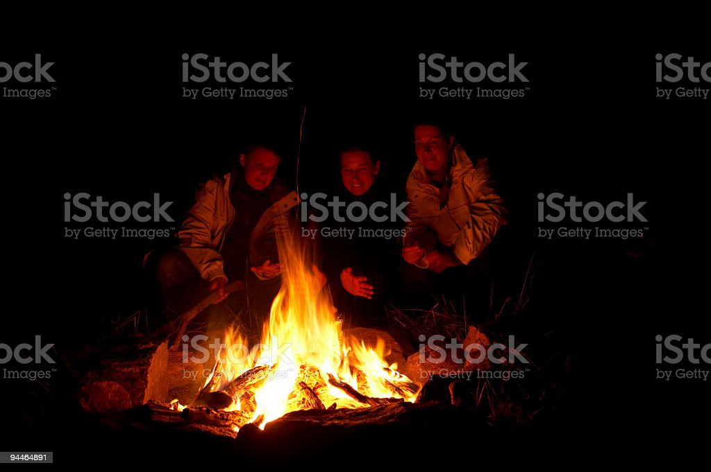 campfire with people stock photo