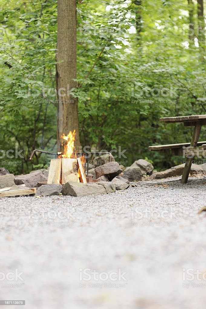 Campfire with picnic table royalty-free stock photo
