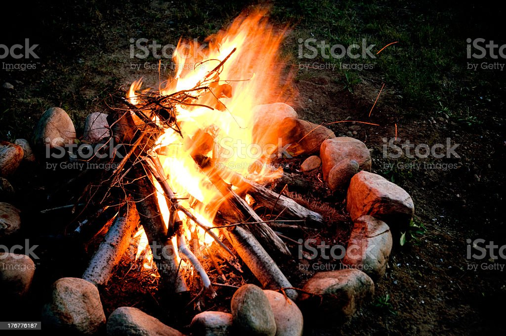 Campfire with rock and dirt fire pit stock photo