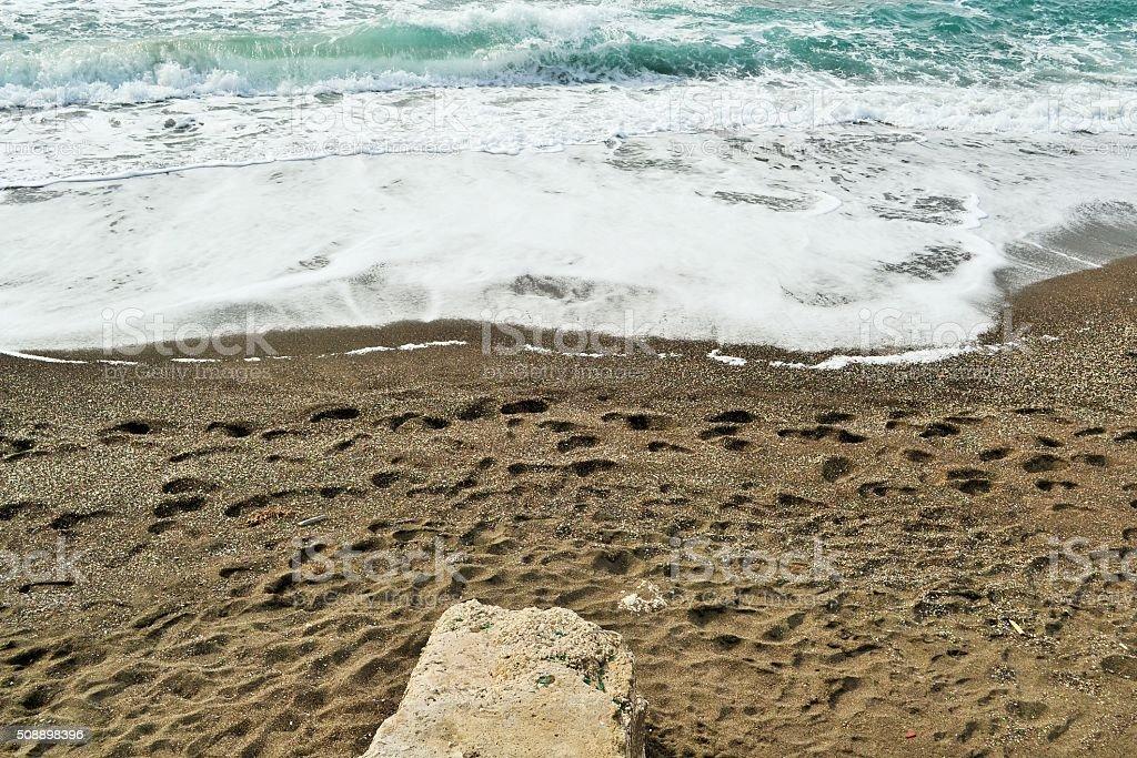 Campi flegrei, orme sulla spiaggia stock photo