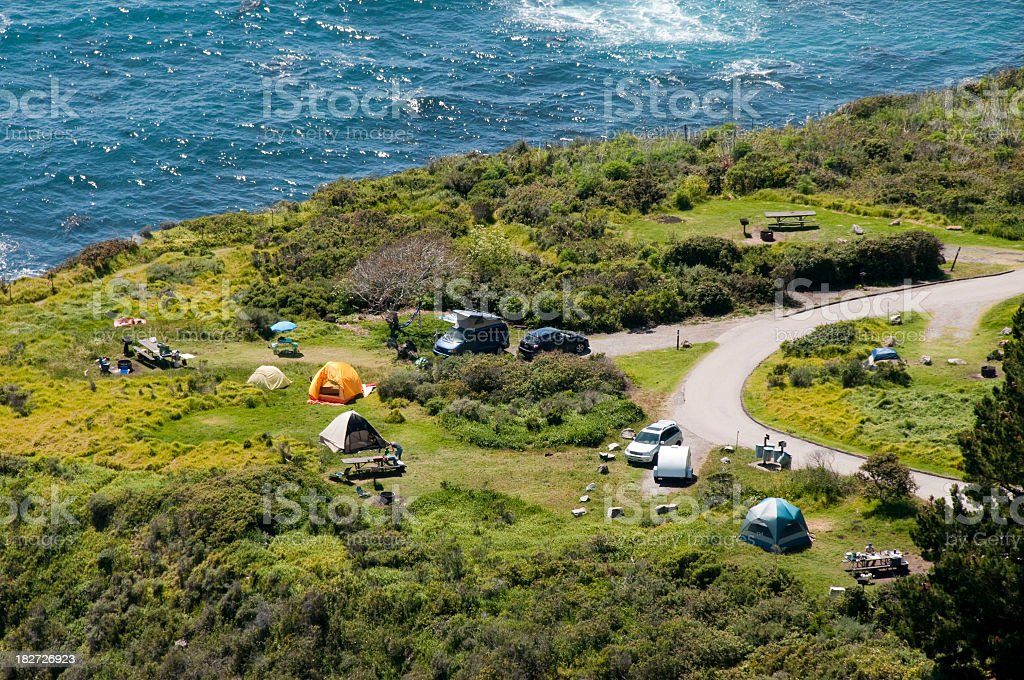 camping along ocean aerial view stock photo