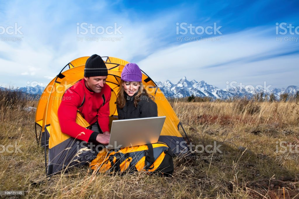 Camping and Technology royalty-free stock photo