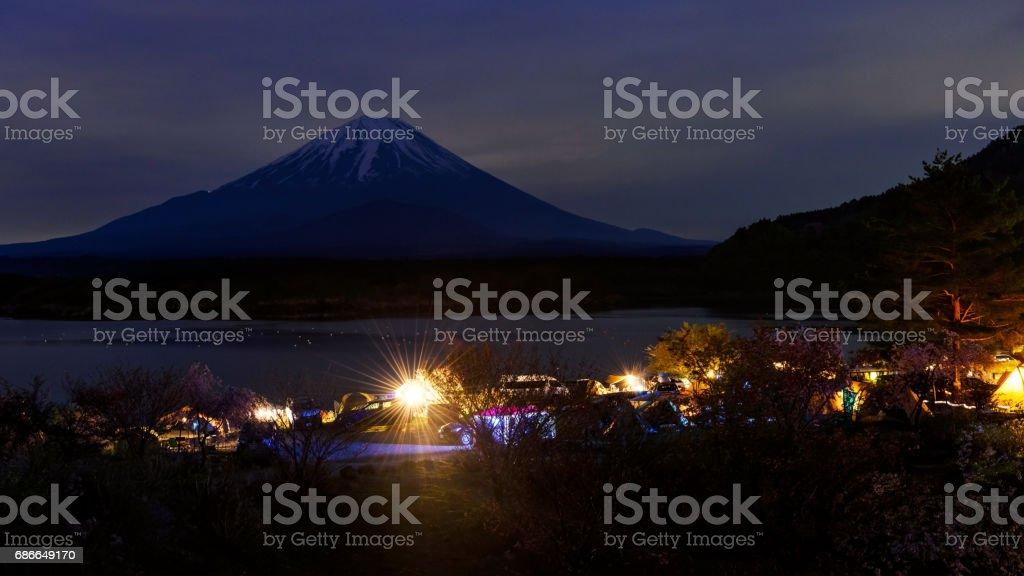 Camping at Shoji lake with Mt. Fuji view at night stock photo