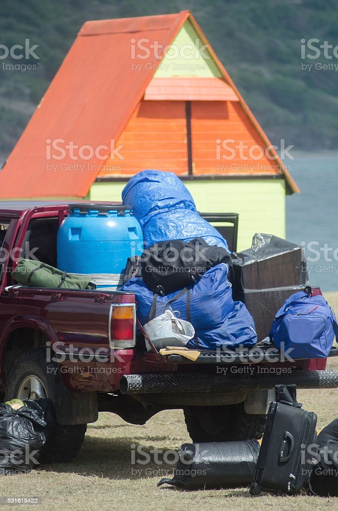 camping cabin and loaded truck with supplies stock photo