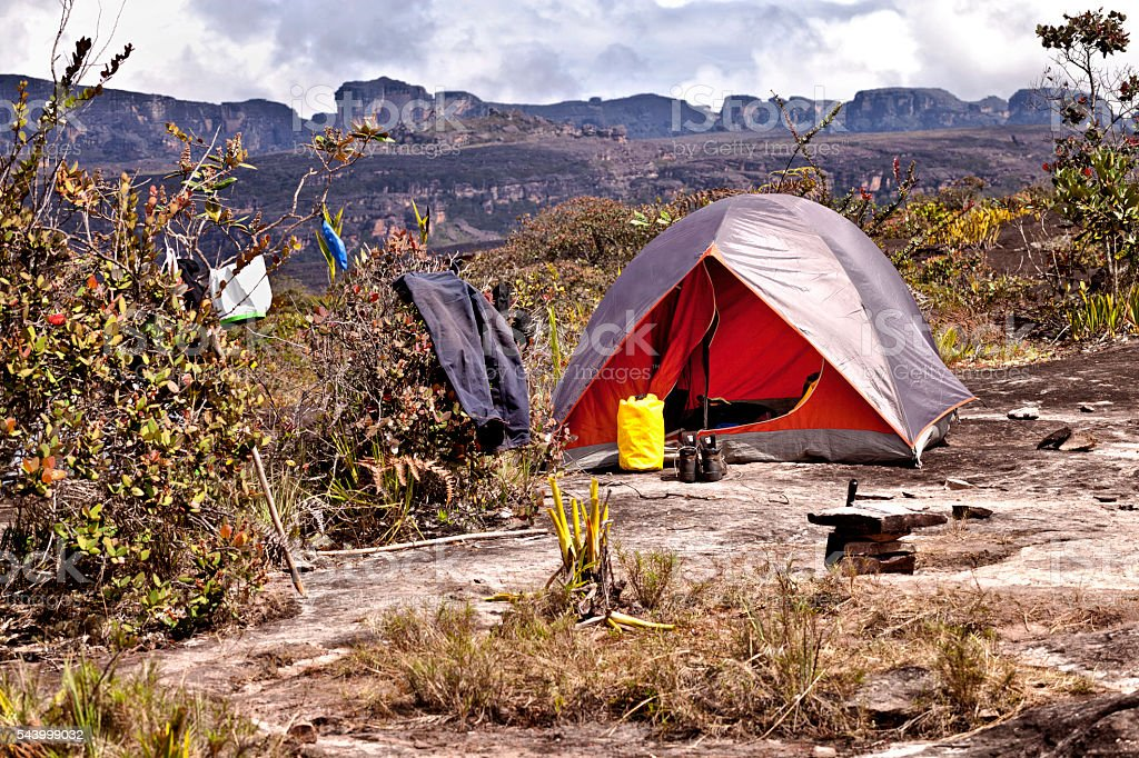 Camping, camp tent on a rocky surface stock photo
