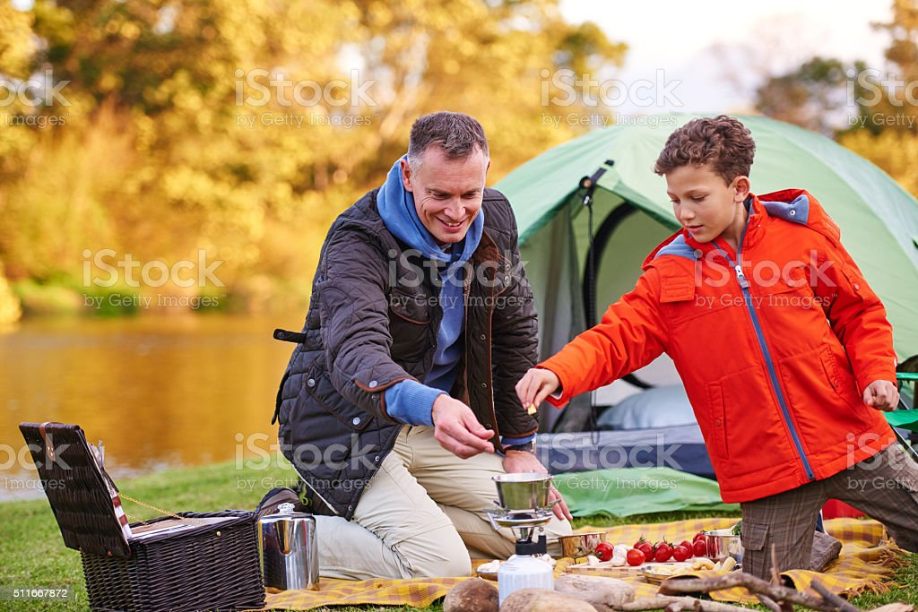 Camping chefs at work! stock photo
