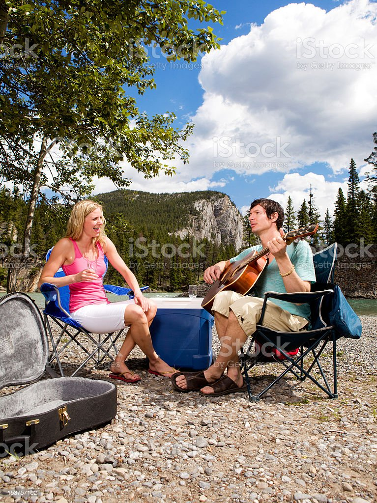 Camping Couple with Guitar royalty-free stock photo
