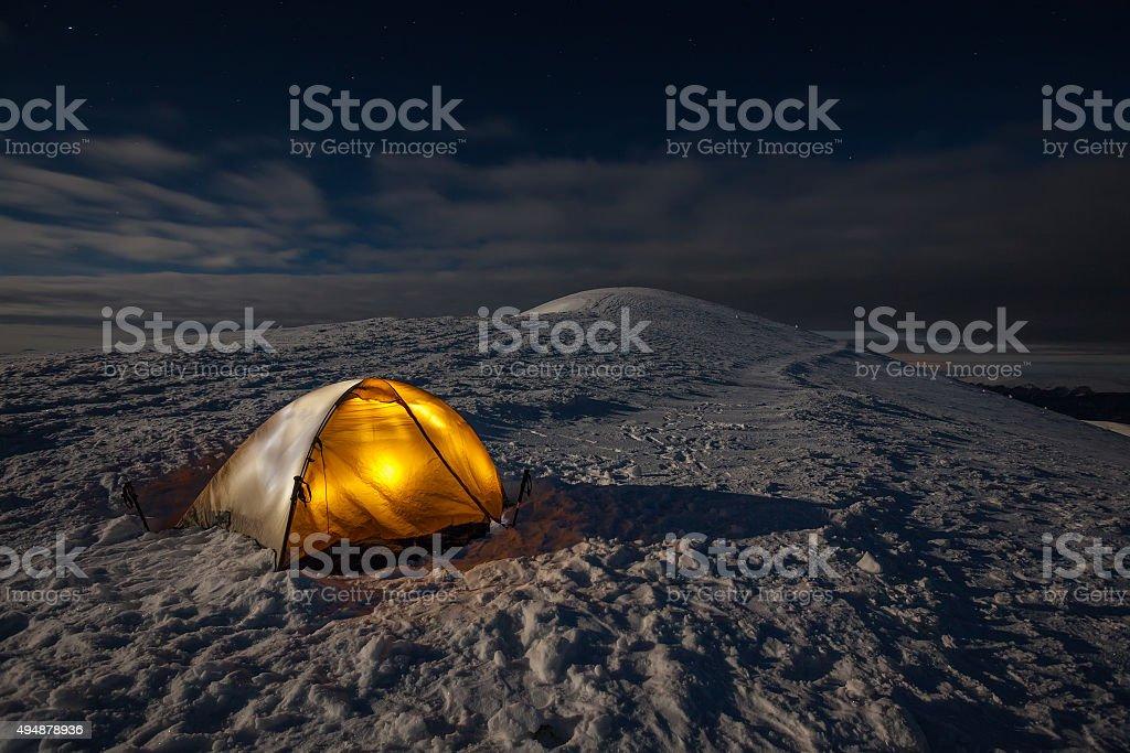 Camping during winter hiking in Carpathian mountains stock photo