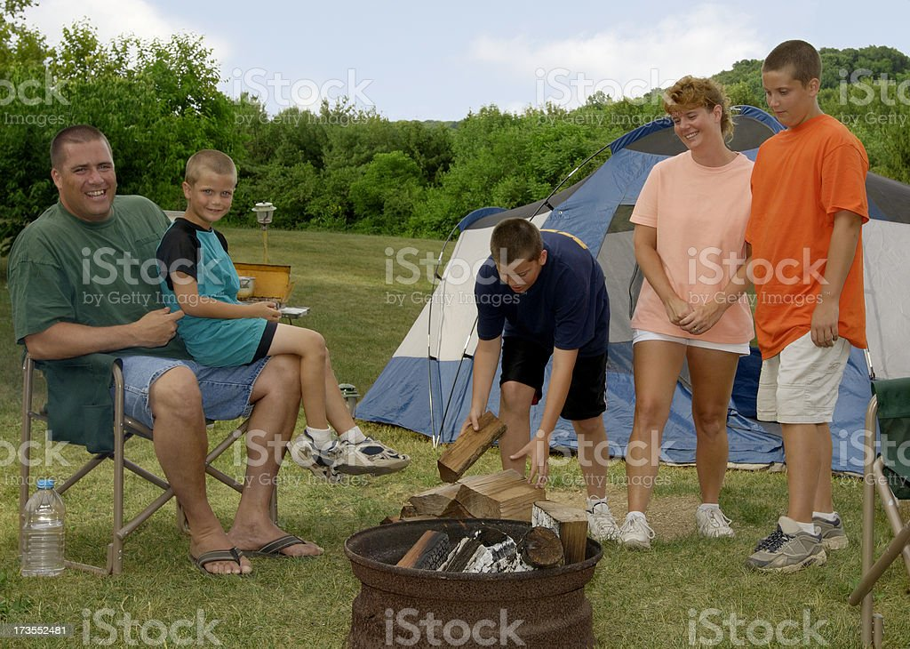 Camping family-firewood royalty-free stock photo