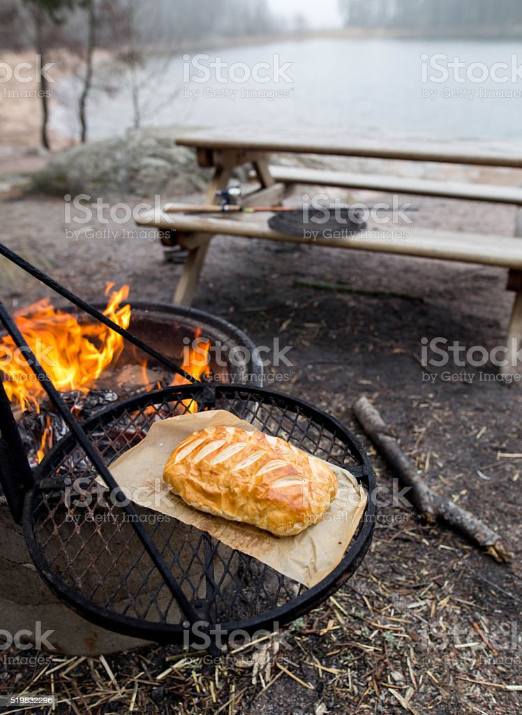 Camping fire and wellinton beef stock photo