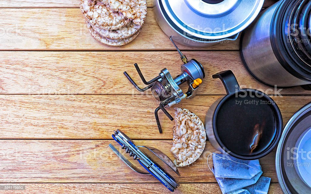 Camping fire equipment lying on a wooden table. stock photo