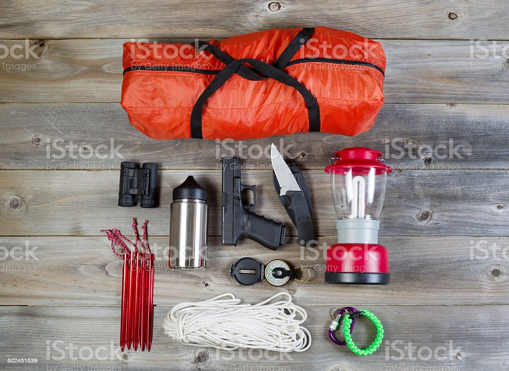 Camping gear and personal protection accessories stock photo