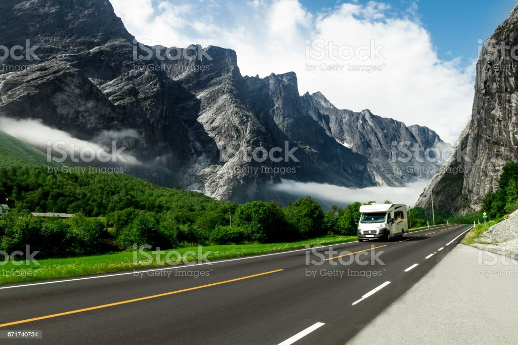 camping holidays car on the mountain road, norway stock photo