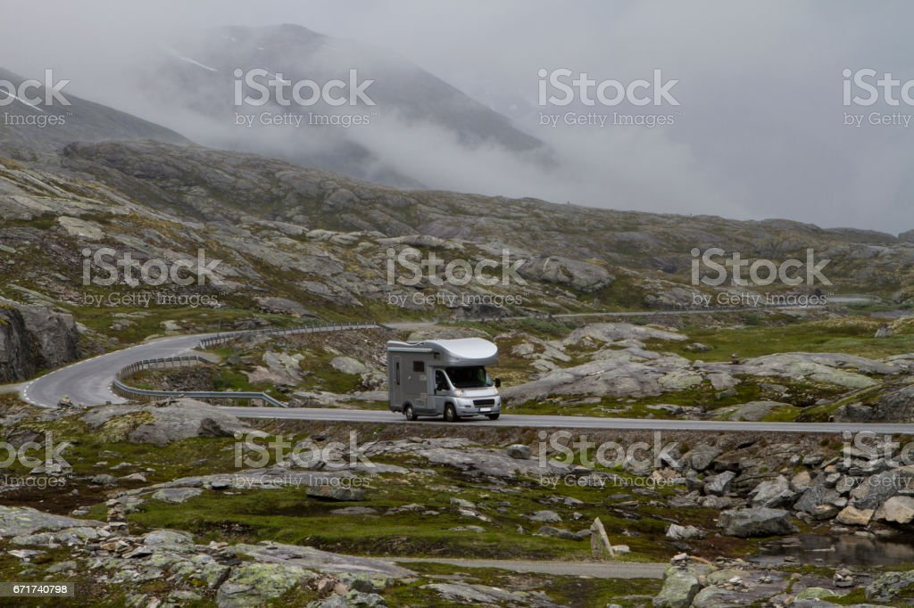 camping holidays car on the mountain road, summer in norway stock photo