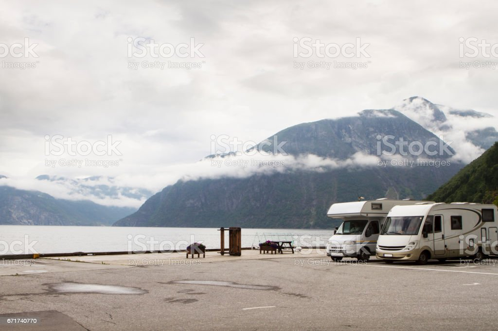 Camping holidays car on the parking near norwegian fjord, summer in norwegian mountains stock photo