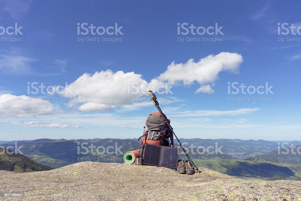 Camping in the mountains with a backpack . stock photo