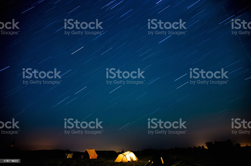 Camping in the night with tracer Stars stock photo