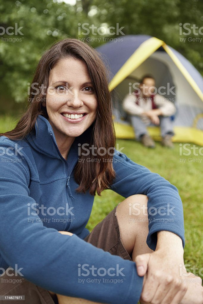 Camping is one of her favourite pastimes royalty-free stock photo
