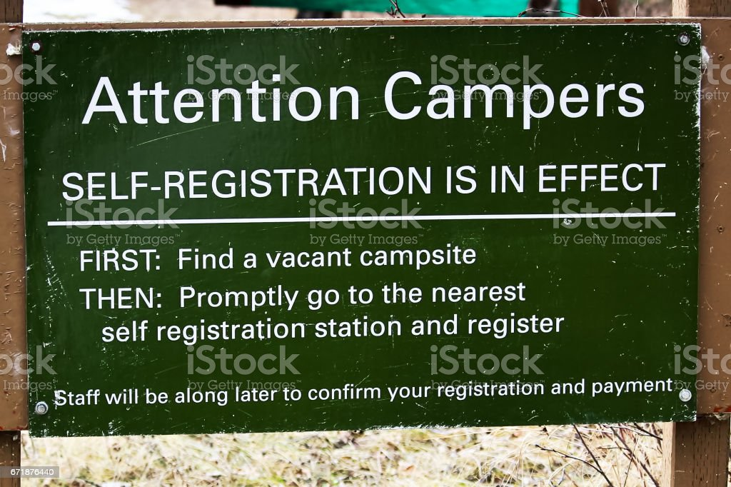 Camping self registration instructions sign stock photo