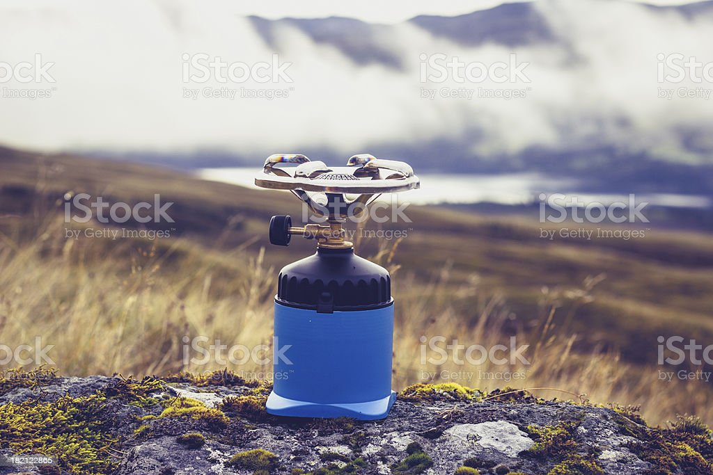 Camping stove on a rock in the mountains royalty-free stock photo